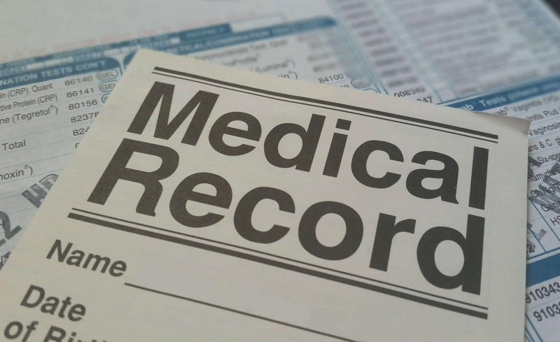 Piece of medical record over other documents